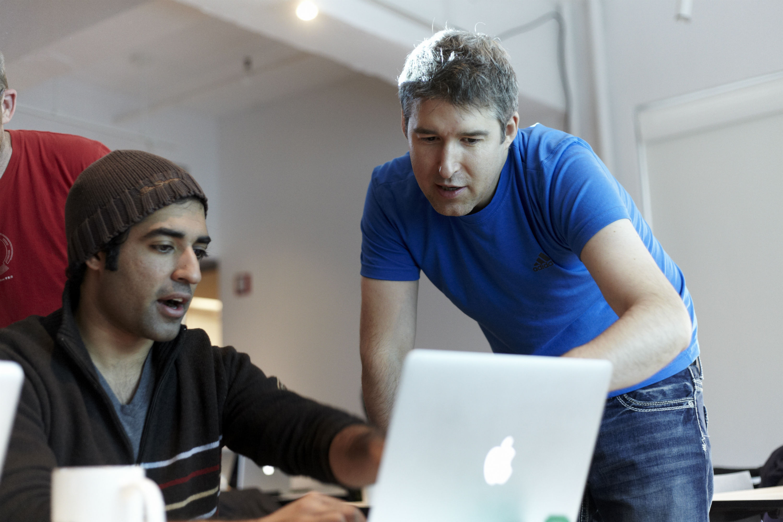 data scientist and web designer working t